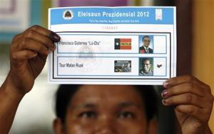 East Timorese election commission shows ballot paper during ballot counting for the second round of presidential election in Dili